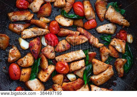 Frying Pan With Hot Italian Food Isolated On White Background. Healthy Chicken Meat, Tomatoes And He