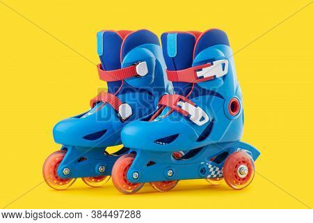 Roller Skates Isolated On A Yellow Background
