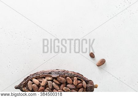 Cocoa Pod With Cocoa Beans On A White Background. Organic Food. Natural Chocolate. Top View, Copy Sp
