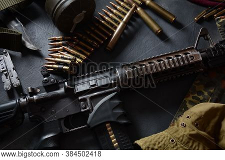Assault Rifle (m4a1)  With Ammunition On Camouflage Uniform,and Military Equipment For Army,bullets