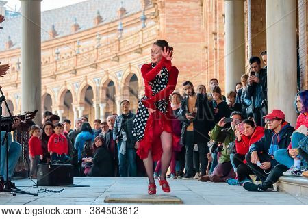 Seville, Spain - January 2, 2020: A Group Of Street Entertainers Performs Flamenco Dancing At Plaza
