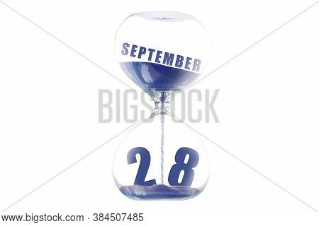 September 28th. Day 28 Of Month, Hour Glass And Calendar Concept. Sand Glass On White Background Wit