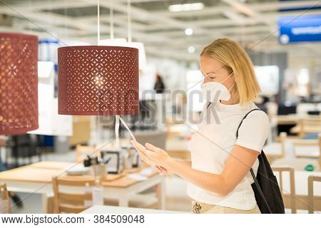 New Normal During Covid Epidemic. Caucasian Woman Shopping At Retail Furniture And Home Accessories