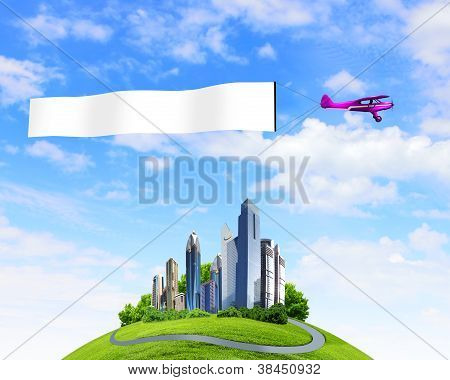 Plane in the sky above the city with blank flag poster