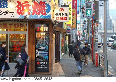 Tokyo, Japan - December 1, 2016: People Walk In Roppongi District Of Tokyo, Japan. Tokyo Is The Capi