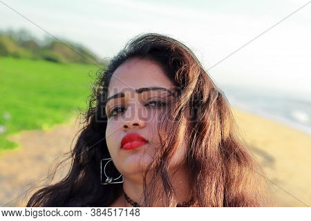 A Beautiful Indian Young Lady Face And Exciting Sexy Red Smooth Lips With Natural Background, Beauty
