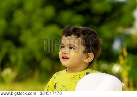A Beautiful Little Indian Child Is Happy With A White Balloon In His Hands, Asian Kids, Portrait Lit