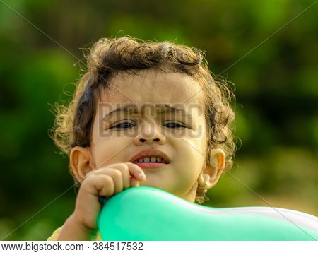 Close View Of A Small Child's Face And Holding A Blue Balloon, Portrait Little Boy Outdoor, Child Ca