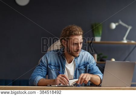 Studying Online, Online Courses.business Concept.young Handsome Curly Smiling Man With Long Hair Stu
