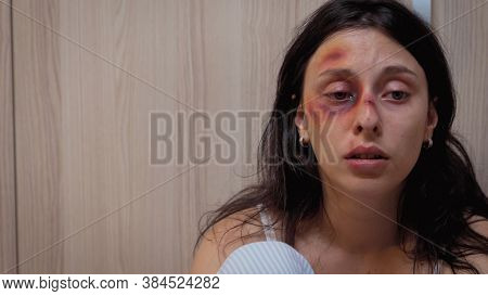 Beaten Woman Trembling With Fear Sitting In The Kitchen Desolated. Traumatised Helpless Terrified Vu