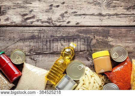 Donations Food: Set Of Staple Products Raw Cereals Canned Food, Grocery Pasta On Wooden Table. Donat