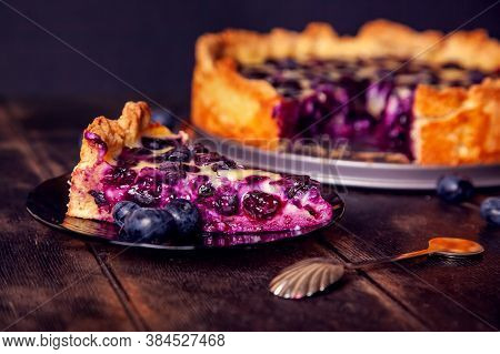Rustic Shortbread Pie With Blueberries In Sour Cream Filling On A Wooden Background With Piece Cut O
