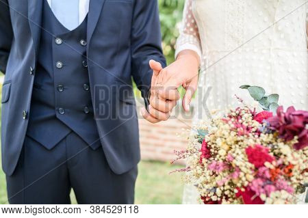 Elegant And Stylish Newly Married Couple Hold Hands With Love.focus Selective.wedding And Celebratio
