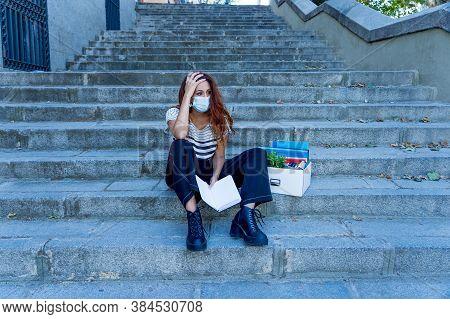 Sad Woman Sitting Outside Office Feeling Hopeless After Being Fired. Coronavirus Job Cuts Crisis