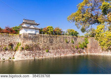 Osaka Castle Park,Osaka,Japan - November 16,2019: the Osaka Castle with moat and stone wall surrounding, the most famous landmark at autumn in Osaka, Japan