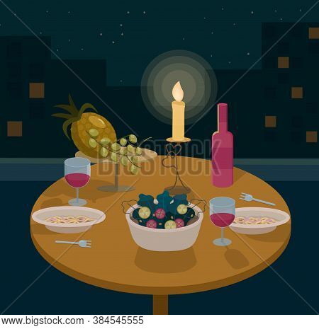 Romantic Dinner On The Rooftop For A Couple. There Is The Night City Behind.