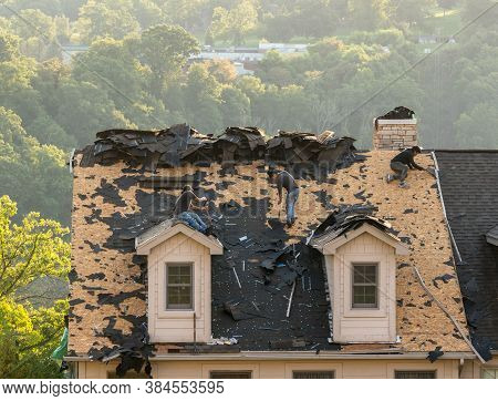 Morgantown, Wv - 8 Spetember 2020: Roofing Contractor Removing The Old Tiles From Townhouse Roof Bef