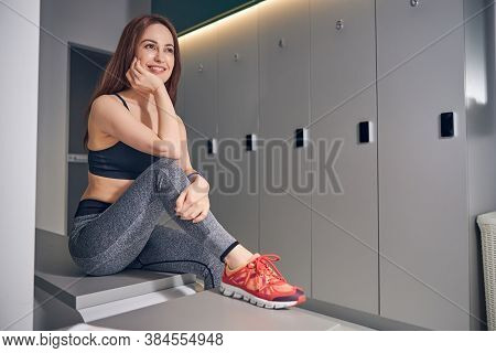 Joyous Female Athlete Gazing Into The Distance
