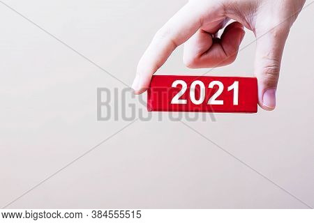 Businessman Hand Holding 2021wooden Block. Resolution, Strategy, Solution, Goal, Risk Business And N