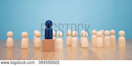 Wooden Figure Standing On The Box For Show Influence And Empowerment. Concept Of Business Leadership