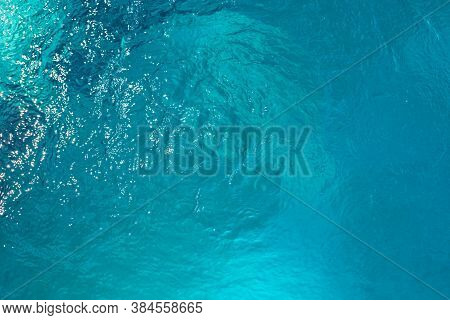 Swimming Pool Water Surface With Ripples. Sport Swimming Facility. Breezy Swimming Pool With Current