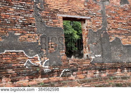 The Brick Wall And Window Of Church In The Ruins Of Ancient Remains At Wat Worachet Temple, It Built