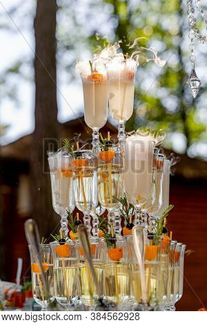 Glass Of Champagne For Event Party Or Wedding Ceremony. Pyramid Of Glasses Of Champagne For Celebrat