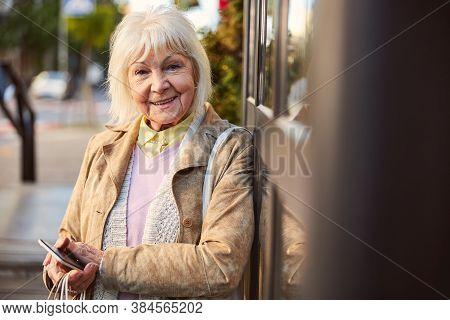 Confident Senior Business Woman Walking In The City