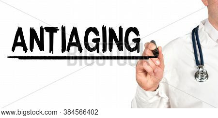Medicine Concept. Doctor Writes The Word - Antiaging. Image Of A Hand Holding A Marker Isolated On A