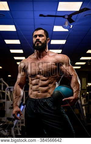 Mighty Strong Young Caucasian Male With Beard Holding Slam Heavy Ball For Workout Training Indoors G