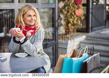 Portrait Of Happy Female Tourist With Shopping Bags