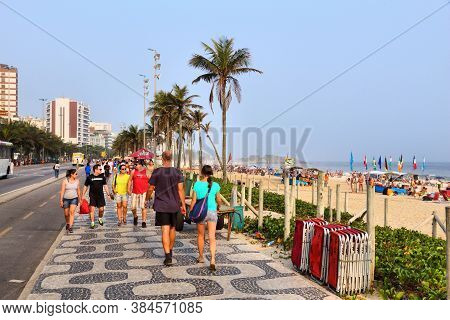 Rio De Janeiro, Brazil - October 18, 2014: People Visit Ipanema Beachfront Walk In Rio De Janeiro. I