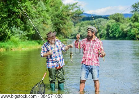 Magnificent Moments. Male Friendship. Family Bonding. Two Fishermen With Fishing Rods. Summer Weeken