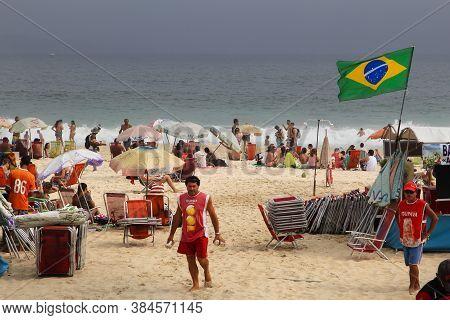 Rio De Janeiro, Brazil - October 18, 2014: People Visit Ipanema Beach In Rio De Janeiro. In 2013 1.6