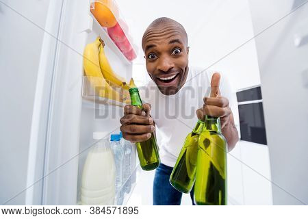 Portrait Of His He Nice Attractive Glad Funky Cheerful Cheery Guy Looking In Fridge Taking Limonade