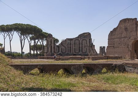 Rome, Italy - June 29, 2010: Some Tourists Walk Near The Remnants Of The Palatine Stadium, In The Ar