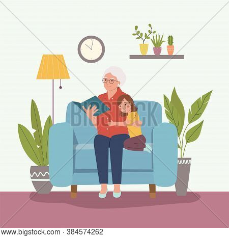 Grandmother Is Reading A Book To Her Granddaughter. Grandmother And Granddaughter Are Sitting In A C