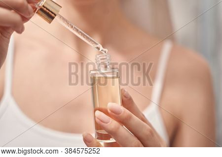 Woman Performing A Beauty Procedure At Home