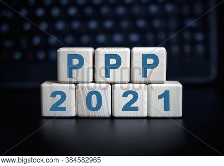 2021 Concept - Ppp Text In Wooden Cubes On A Black Keyboard