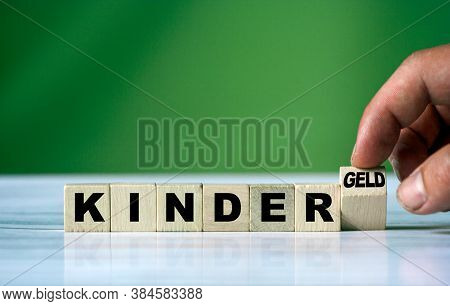 A Hand Turn Wooden Block And Change German Word