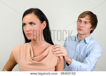 Young Couple Quarreling. Man Asks For Forgiveness.