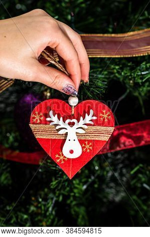 Decorating Christmas Tree, Hand Putting Christmas Decorations On Fir Branches. Christmas Hanging Dec
