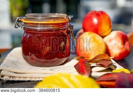 Nectarine Jam And Fresh Nectarines. Homemade Nectarine Jam With Fresh Organic Nectarines On Wooden R
