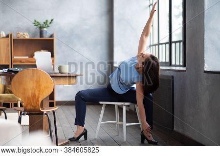 Caucasian Girl Workout Doing Goddess Pose Temple Or Sumo Pose, Stupasana