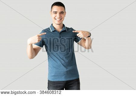 Portrait Of A Happy Hispanic Guy Pointing At Himself And Looking Excited About Being Chosen In A Stu