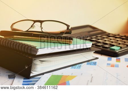 Calculator And Pencil. Office Equipment At Workplace. Conceptual Image Of Desk Work, Financial Paper
