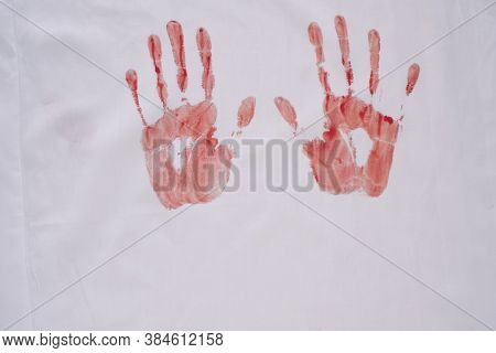 Red Silhouette Of Handprints Isolated On White Background