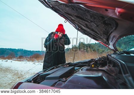 Woman Looking At Car Engine Road Assistance
