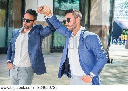 Thinking By Mirror. Young European Businessman With Beard, Wearing White Shirt, Blue Jacket, Sunglas