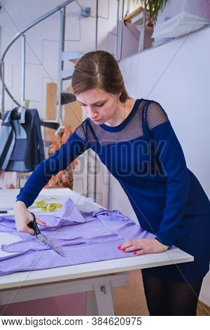 Portrait Of Professional Dressmaker, Seamstress Cutting Fabric With Scissors At Sewing Studio, Ateli